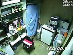 Hidden cam captures this amateur couple fucking in back enclosure