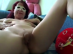 Grouchy redhead surprises us with a private deprecate video in sexy mask