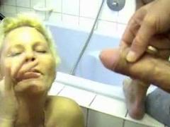 Milf gets him off in her bathroom